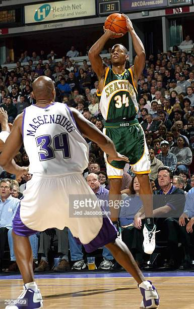 Ray Allen of the Seattle SuperSonics shoots over Tony Massenburg of the Sacramento Kings during an NBA game on February 3 2004 at Arco Arena in...