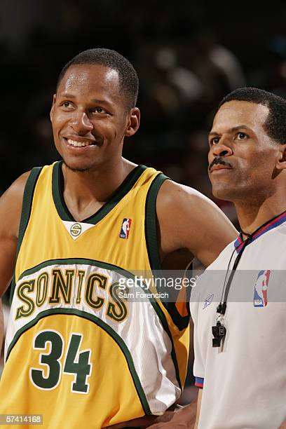 Ray Allen of the Seattle SuperSonics stands next to referee Eric Lewis during the game against the Portland Trail Blazers at the Rose Garden Arena on...
