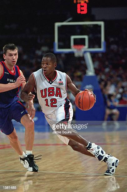 Ray Allen of the USA dribbles around his defender during the men's quarterfinals game against Russia at the Sydney SuperDome during the Sydney...