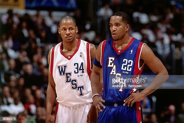 Ray Allen of the West AllStars and Michael Redd of the East AllStars look on during the 2004 NBA AllStar Game at the Staples Center part of the 53rd...