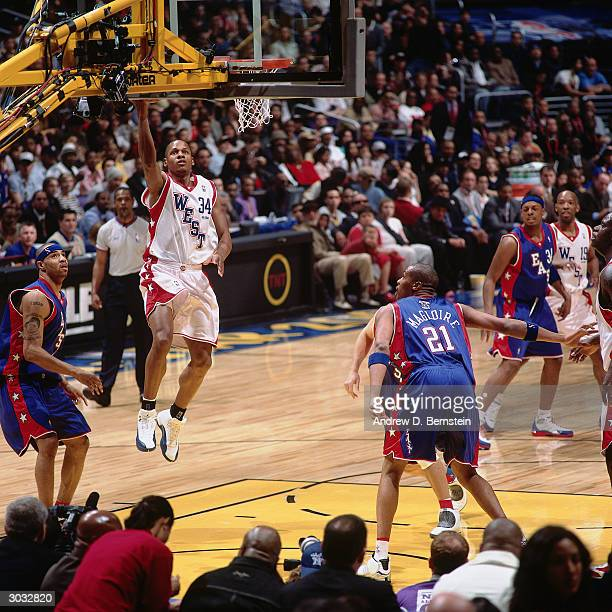 Ray Allen of the West AllStars attempts a layup against the East AllStars during the 2004 NBA AllStar Game at the Staples Center part of the 53rd NBA...