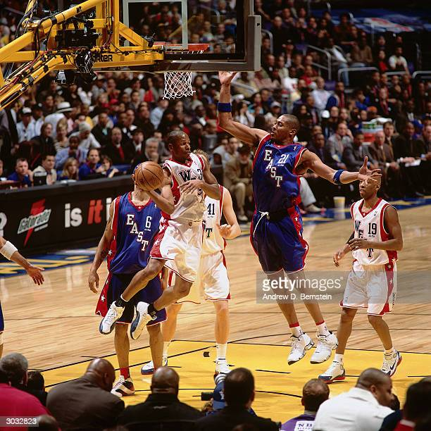 Ray Allen of the West AllStars attempts to pass the ball against Jamaal Magloire of the East AllStars during the 2004 NBA AllStar Game at the Staples...