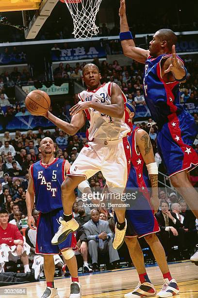 Ray Allen of the West AllStars looks to pass the ball around Jamaal Magloire of the East AllStars uring the 2004 NBA AllStar Game at the Staples...