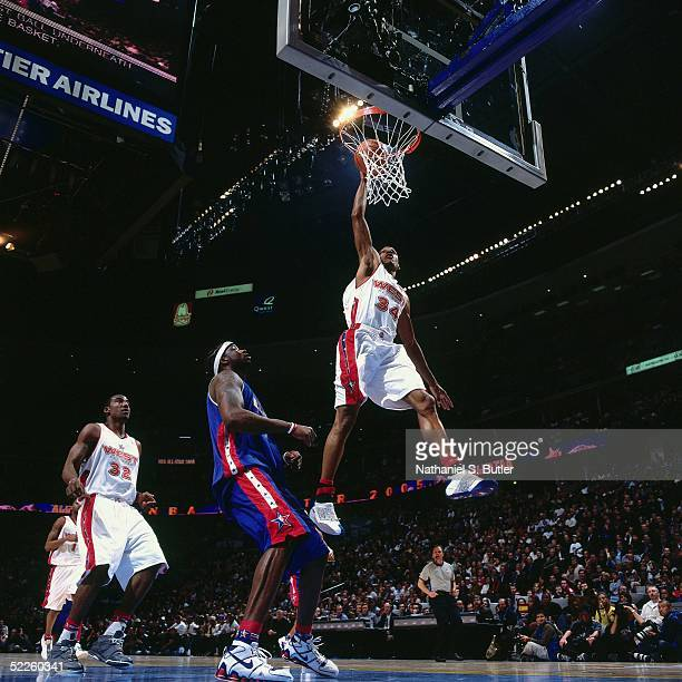 Ray Allen of the Western Conference AllStars dunks against Jermaine O'Neal of the Eastern Conference AllStars during the 2005 AllStar Game on...