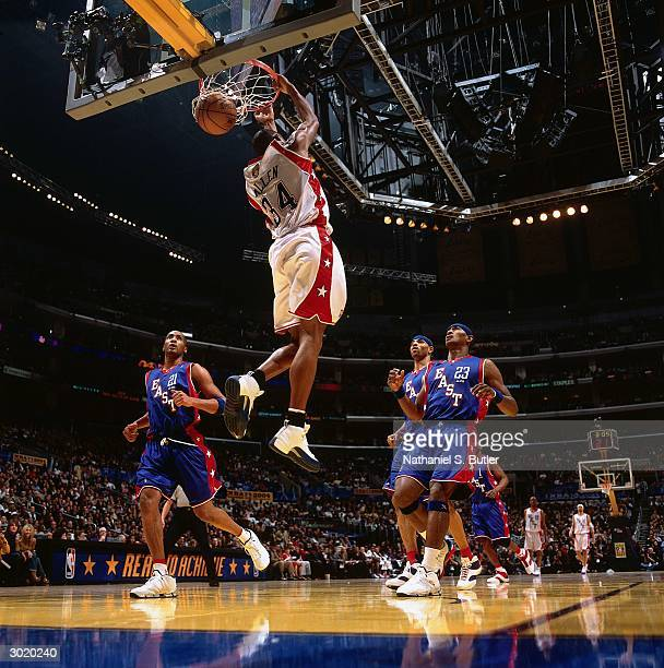 Ray Allen of the Western Conference AllStars dunks against the Eastern Conference AllStars during the 2004 AllStar Game on February 15 2004 at...