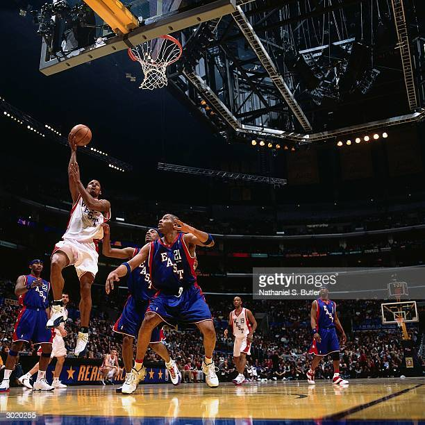 Ray Allen of the Western Conference AllStars shoots against Jamaal Magloire of the Eastern Conference AllStars during the 2004 AllStar Game on...