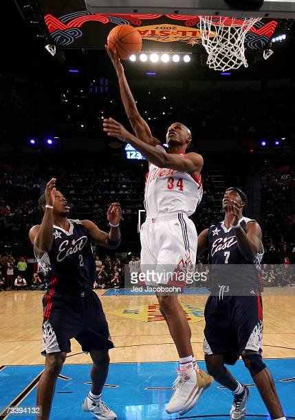 Ray Allen of the Western Conference lays the ball up over Joe Johnson and Jermaine O'Neal of the Eastern Conference during the 2007 NBA AllStar Game...