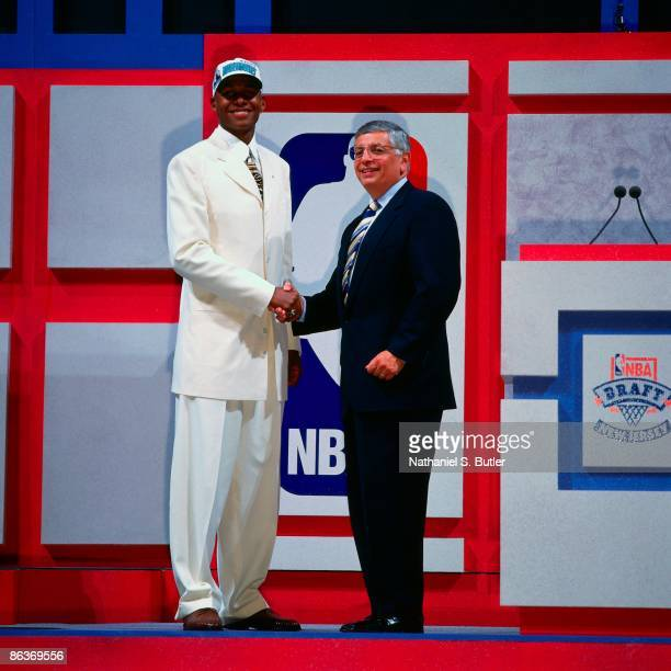 Ray Allen shakes hands with NBA Commissioner David Stern after being selected fifth overall by the Minnesota Timberwolves during the 1996 NBA Draft...