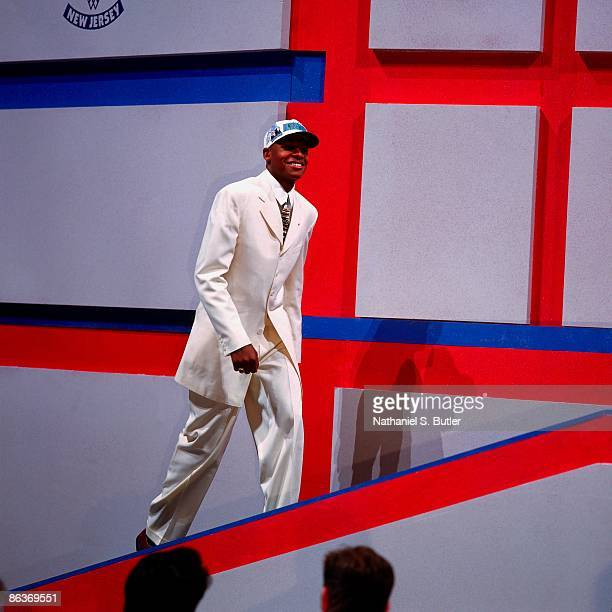 Ray Allen walks up the stage after being selected fifth overall by the Minnesota Timberwolves during the 1996 NBA Draft on June 26 1996 at the...