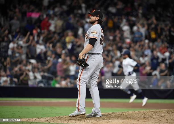 Ray Black of the San Francisco Giants stands on the mound after giving up a threerun home run to Freddy Galvis of the San Diego Padres during the...