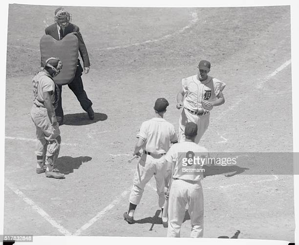 Ray Boone of the Detroit Tigers is coming home after slapping out a homer in the third inning of the allstar game against the national leaguers today...