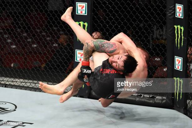 Ray Borg takes down Casey Kenney in their bantamweight bout during the UFC Fight Night Event event at Wells Fargo Center on March 30, 2019 in...