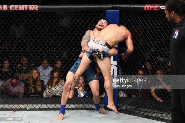Ray Borg takes down Rogerio Bontorin of Brazil in their flyweight bout during the UFC Fight Night event at Santa Ana Star Center on February 15, 2020...