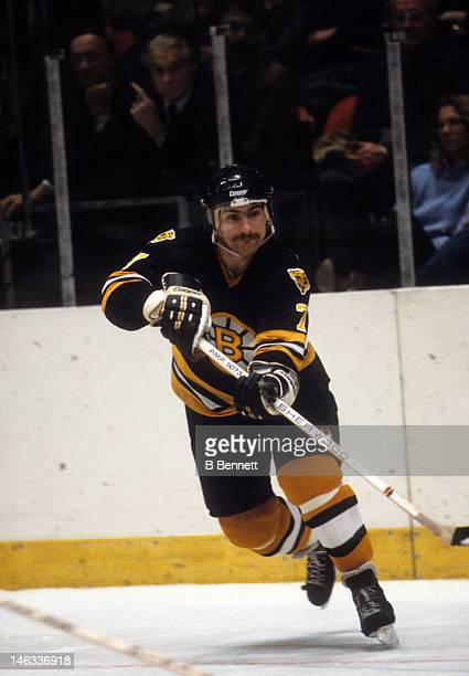 Ray Bourque of the Boston Bruins passes the puck during an NHL game in January 1983