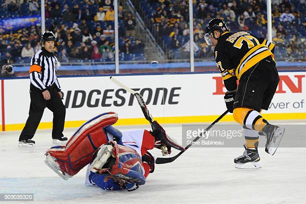 Ray Bourque of the Boston Bruins scores in a shoot out against Richard Sevigny of the Montreal Canadiens in the alumni game December 31 2015 during...
