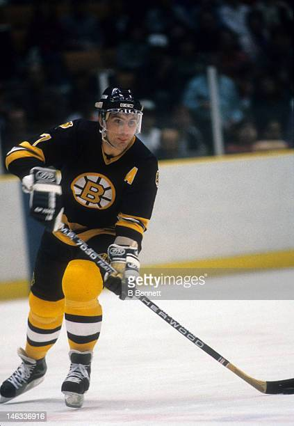 Ray Bourque of the Boston Bruins skates with the puck during an NHL game against the New Jersey Devils on October 11 1986 at the Brendan Byrne Arena...