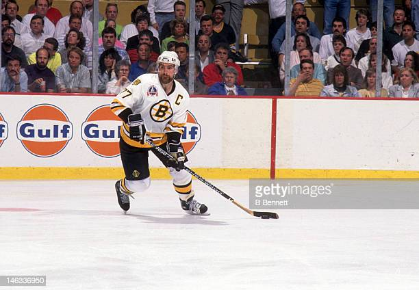 Ray Bourque of the Boston Bruins skates with the puck during the 1990 Stanley Cup Finals against the Edmonton Oilers in May 1990 at the Boston Garden...