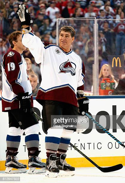 Ray Bourque of the Colorado Avalanche Alumni ackonwledges the fans prior to the 2016 Coors Light Stadium Series Alumni Game against the Detroit Red...