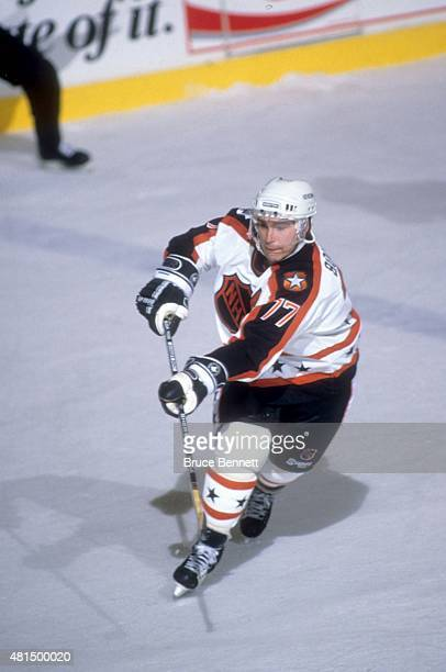 Ray Bourque of the Wales Conference and the Boston Bruins passes the puck during the 1990 41st NHL AllStar Game against the Campbell Conference on...