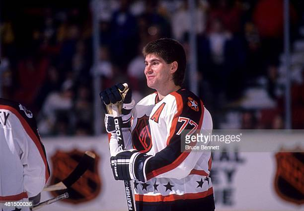 Ray Bourque of the Wales Conference and the Boston Bruins stands on the ice before the 1990 41st NHL AllStar Game against the Campbell Conference on...