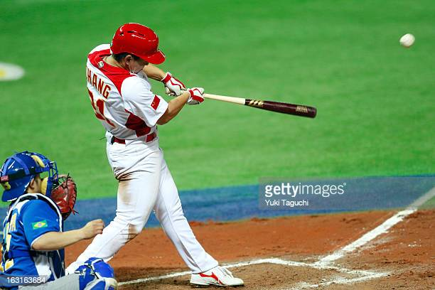 Ray Chang of Team China hits a two run RBI single in the bottom of the eighth inning during Pool A Game 5 between Team Brazil and Team China during...