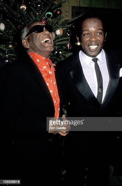 Ray Charles and Lou Rawls during United Negro College Fund Party - December 3, 1987 at Chasen's in Beverly Hills, California, United States.