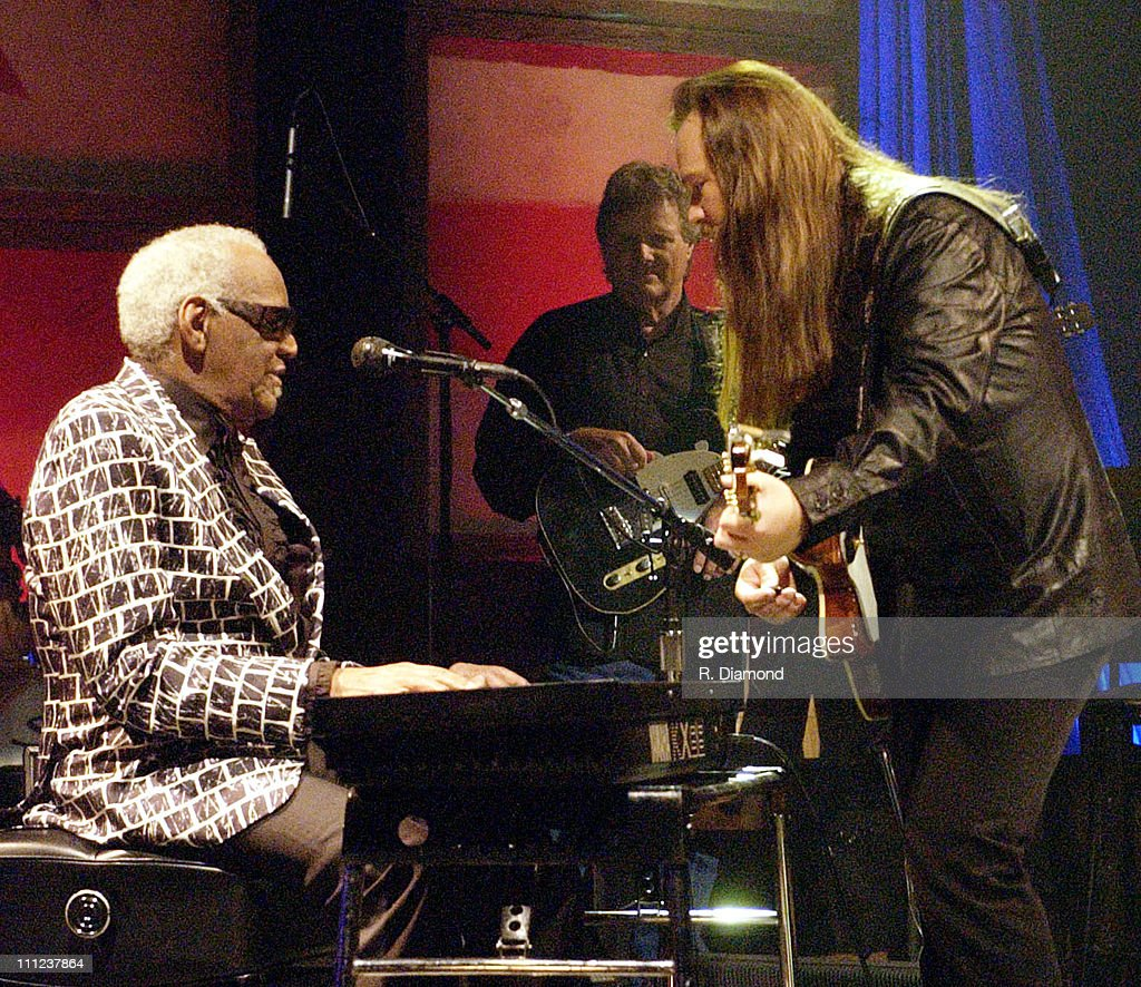 Ray Charles (left) and Travis Tritt (far right) during Ray Charles and Travis Tritt Perform on CMT's Crossroads at Grand Old Opry House in Nashville, Tennessee, United States.