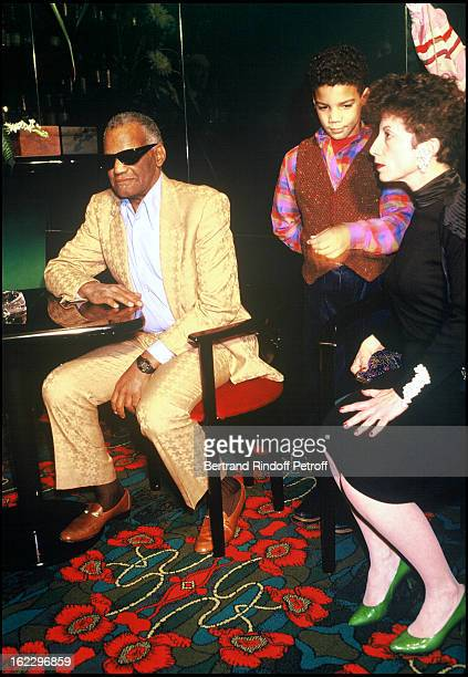 Ray Charles Arts and Letters Commander with his wife and grandson
