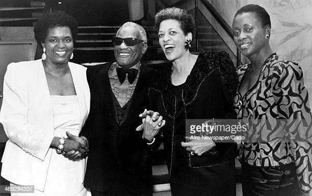 Ray Charles blind musician and soul singer at the 16th National Conference on Blacks in Higher Education with two college presidents and a woman from...