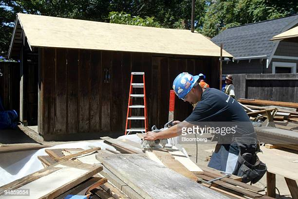Ray Cordero Jr. Cuts wood near the 'HP garage' on the grounds of 367 Addison Ave. In Palo Alto, California Thursday, June 30, 2005. The garage was...