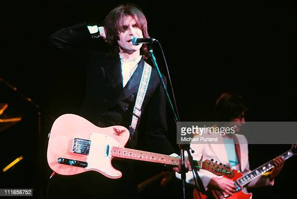 Ray Davies and Dave Davies of the Kinks perform on stage London February 1977