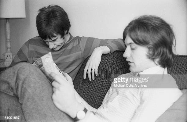Ray Davies and Dave Davies of the rock group 'The Kinks' relax in their hotel room in August 1965 in New York New York