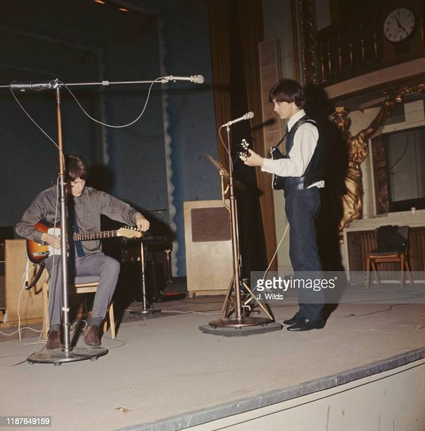 Ray Davies and his brother Dave Davies of The Kinks at a soundcheck before a session for the BBC at the Playhouse Theatre London 7th September 1964