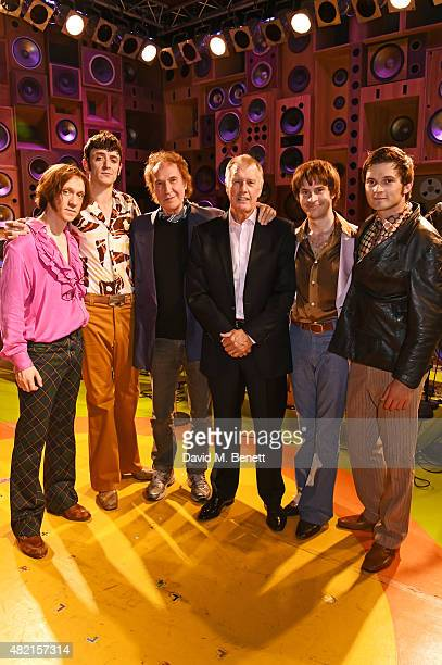 Ray Davies and Sir Geoff Hurst pose onstage with cast members Ryan O'Donnell John Dagleish Adam Sopp and Ned Derrington following a performance of...
