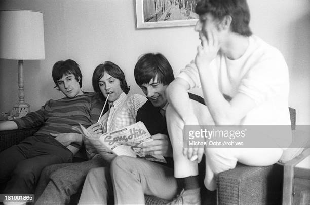Ray Davies Dave Davies Mick Avory and Peter Quaife of the rock group The Kinks relax in their hotel room in August 1965 in New York New York