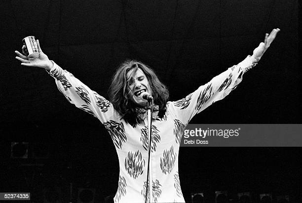 Ray Davies of The Kinks holds a can of light ale while singing 'Alcohol' on stage at White City Stadium London 1973