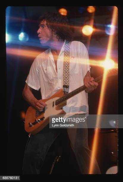 Ray Davies singer and guitarist for the British rock band The Kinks points to the audience as he sings during a performance