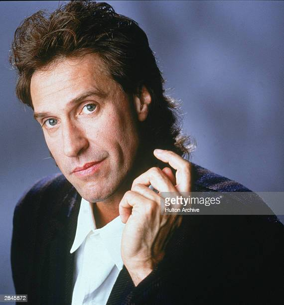 Ray Davies singer and guitarist for the Kinks poses for a studio portrait 1986