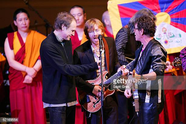 Ray Davies Trey Anastasio and Lou Reed perform onstage during the 15th annual Tibet House benefit concert at Carnegie Hall February 9 2005 in New...