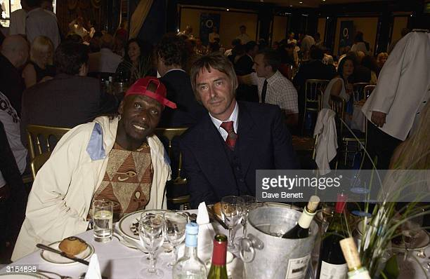 Ray Davis and Paul Weller attend the 2003 Music Therapy Silver Cleft Awards at The Intercontinental Hotel on June 27 2003 in London