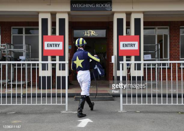 Ray Dawson walks back to the weighing room after winning the Betway Fillies' Handicap at Lingfield Park racecourse on September 2 2020 in Lingfield...