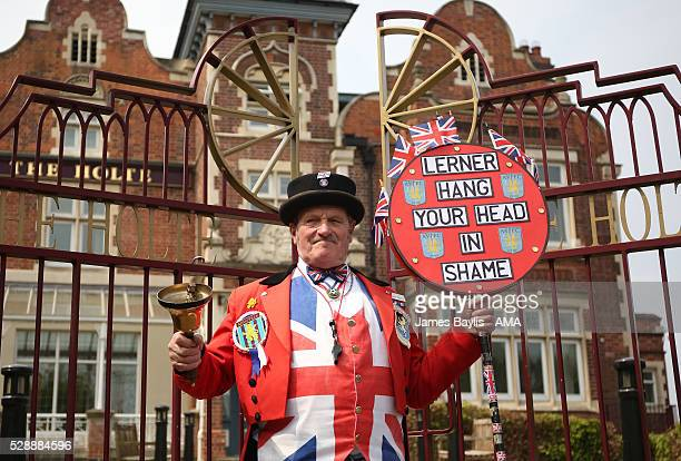Ray Egan protests against Aston Villa owner Randy Lerner before the Barclays Premier League match between Aston Villa and Newcastle United at Villa...
