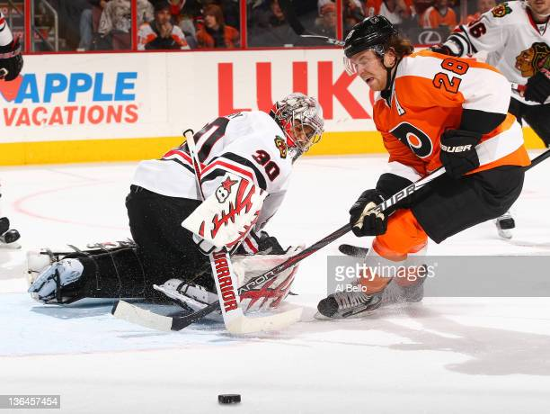 Ray Emery of the Chicago Blackhawks makes a save against Claude Giroux of the Philadelphia Flyers during their game on January 5 2012 at The Wells...