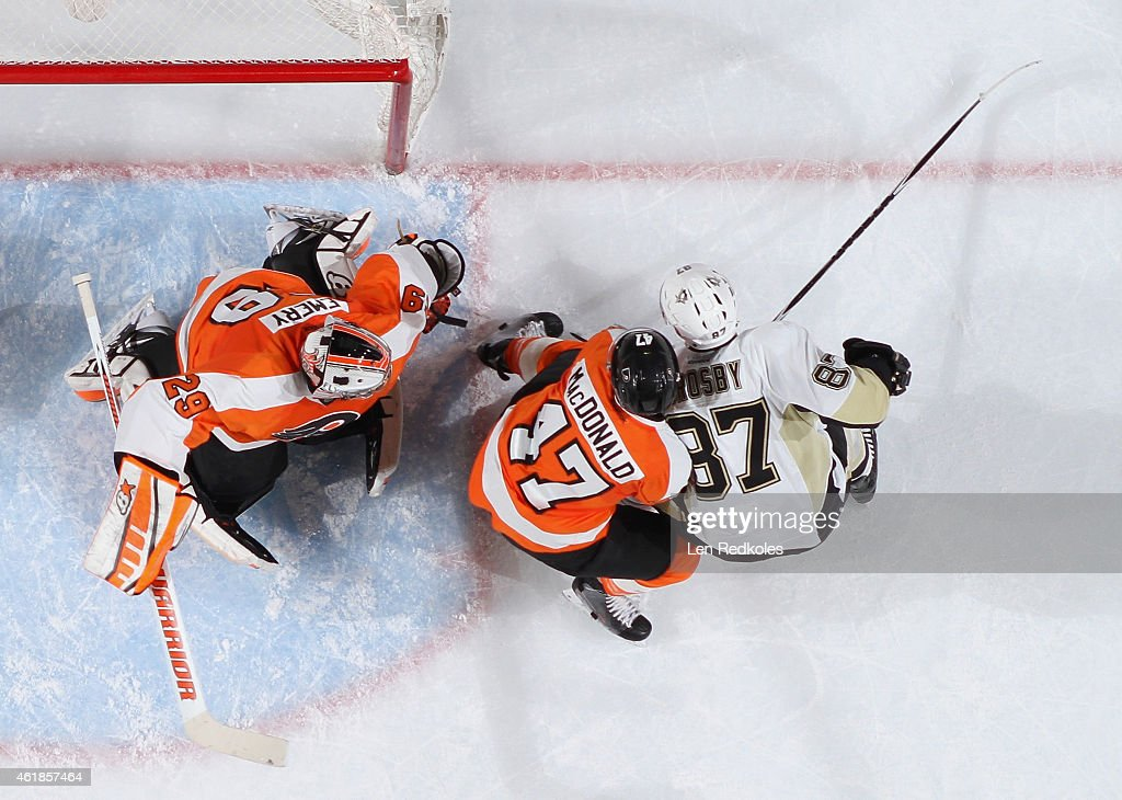 Ray Emery #29 of the Philadelphia Flyers defends his net as teammate Andrew MacDonald #47 defends against Sidney Crosby #87 of the Pittsburgh Penguins on January 20, 2015 at the Wells Fargo Center in Philadelphia, Pennsylvania. The Flyers went on to defeat the Penguins 3-2 in overtime.