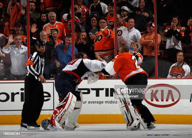 Ray Emery of the Philadelphia Flyers fights with Braden Holtby of the Washington Capitals during the third period at the Wells Fargo Center on...