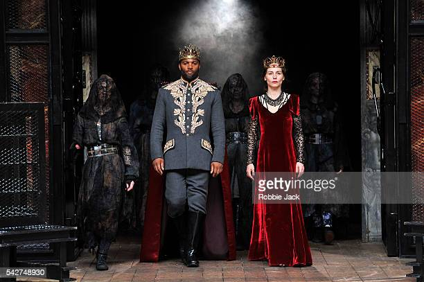Ray Fearon as Macbeth and Tara Fitzgerald as Lady Macbeth with artists of the company in William Shakespeare's Macbeth directed by Iqban Khan at The...