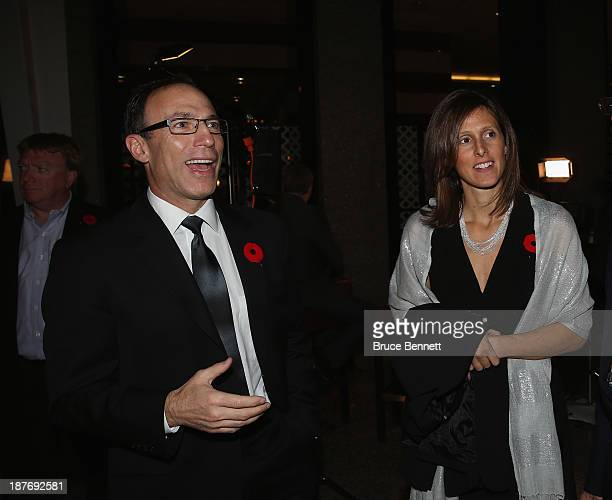 Ray Ferraro and his wife Cammi Granato walk the red carpet prior to the 2013 Hockey Hall of Fame induction ceremony on November 11 2013 in Toronto...