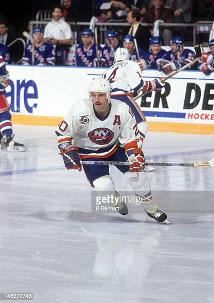 Ray Ferraro of the New York Islanders skates on the ice during an NHL game against the New York Rangers circa 1992 at the Nassau Coliseum in...