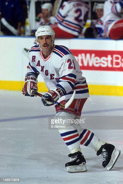 Ray Ferraro of the New York Rangers skates on the ice during an NHL game circa 1996 at the Madison Square Garden in New York New York