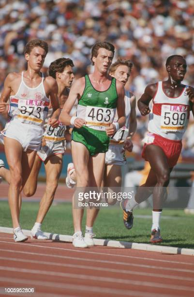 Ray Flynn of Ireland leads Tim Hutchings of Great Britain and Wilson Waigwa of Kenya in heat 1 of the Men's 5000 metres event inside the Memorial...